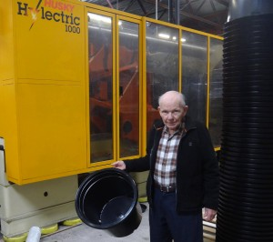 Founder George Anderson holding Anderson's new design #15 pot for wholesale nurseries.